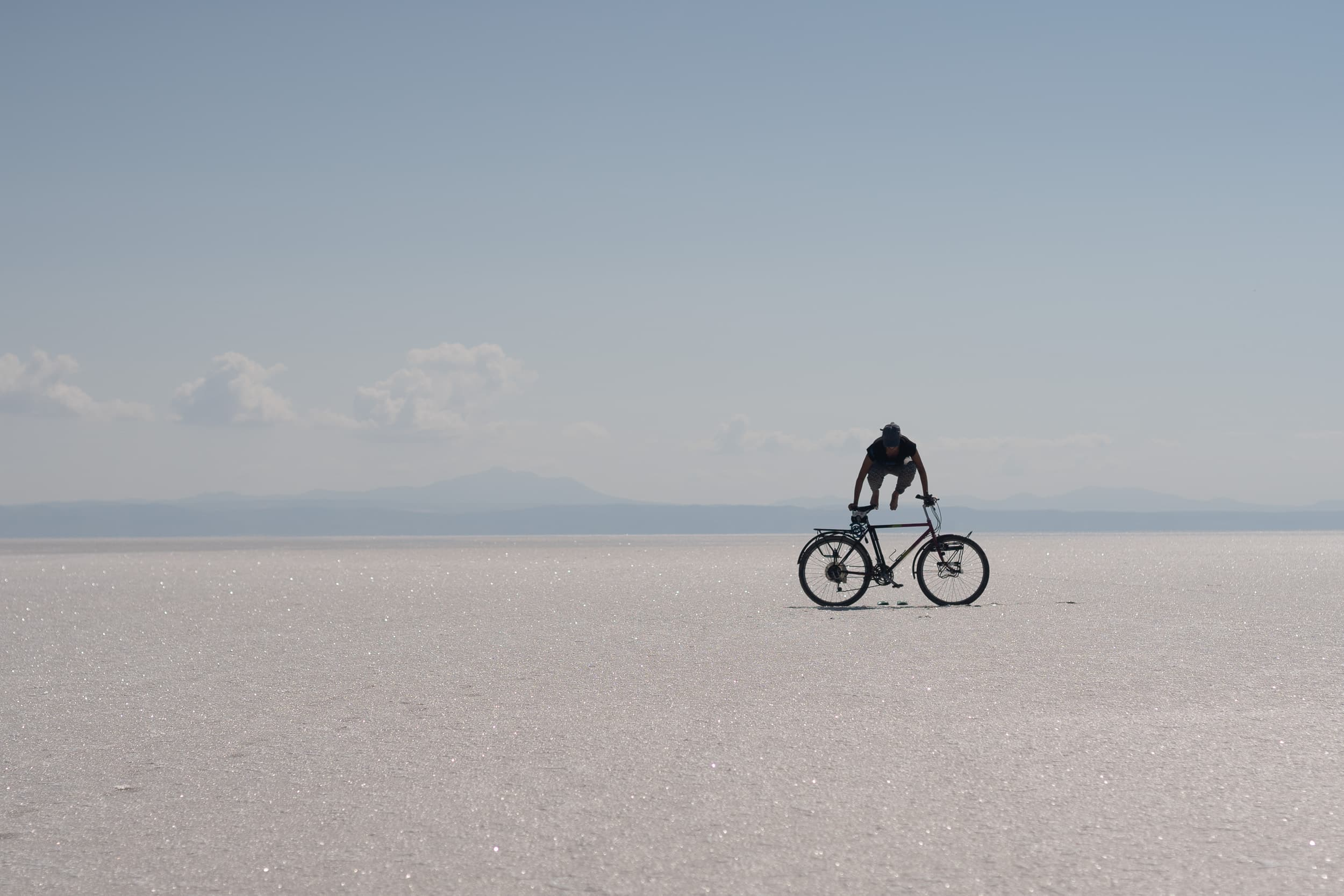 bicycle tourer on Tuzla Gölü salt lake in Turkey