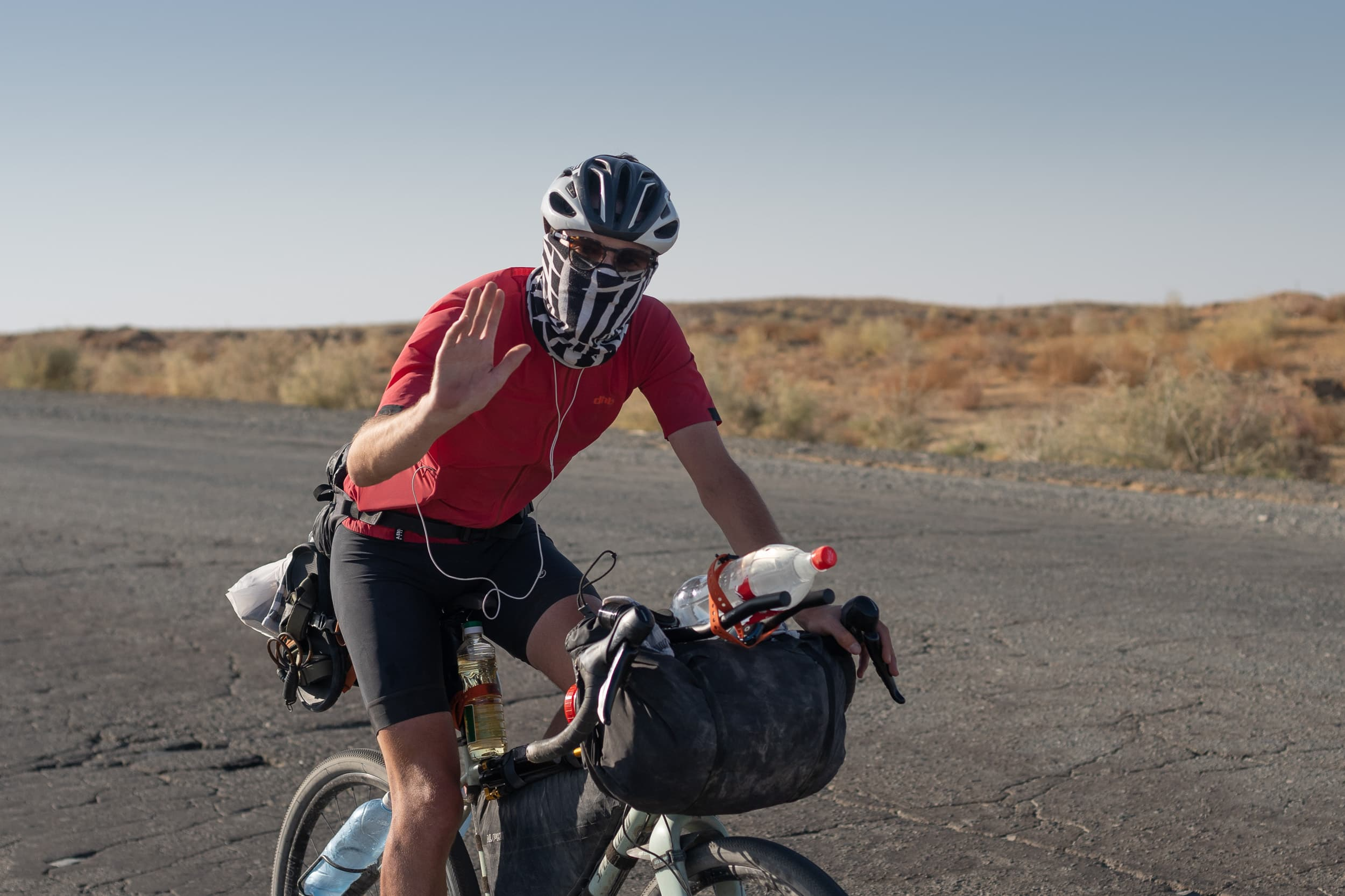 Andrew cycling the Kysylkum desert