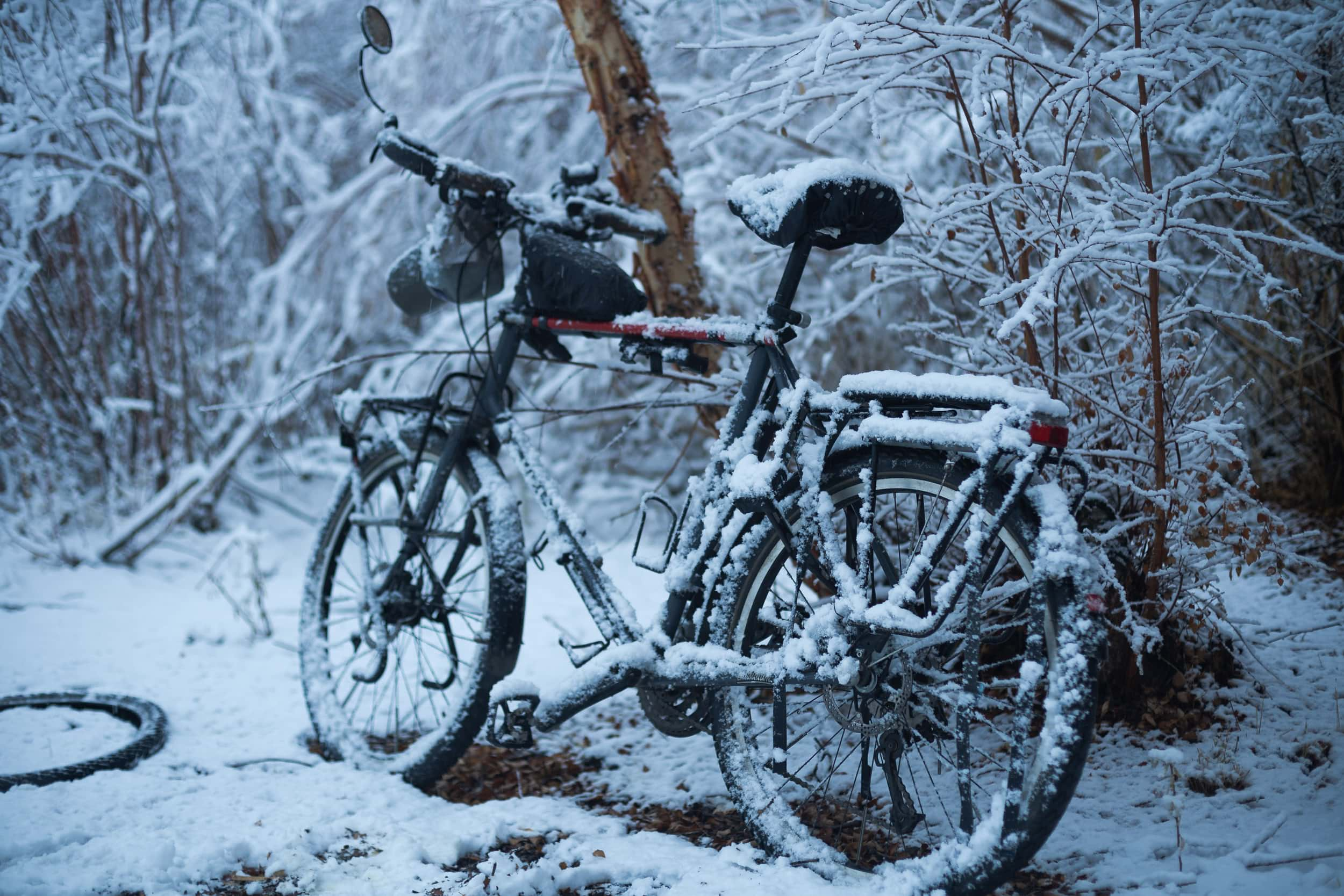 Snow covered touring bicycle Bartang Valley