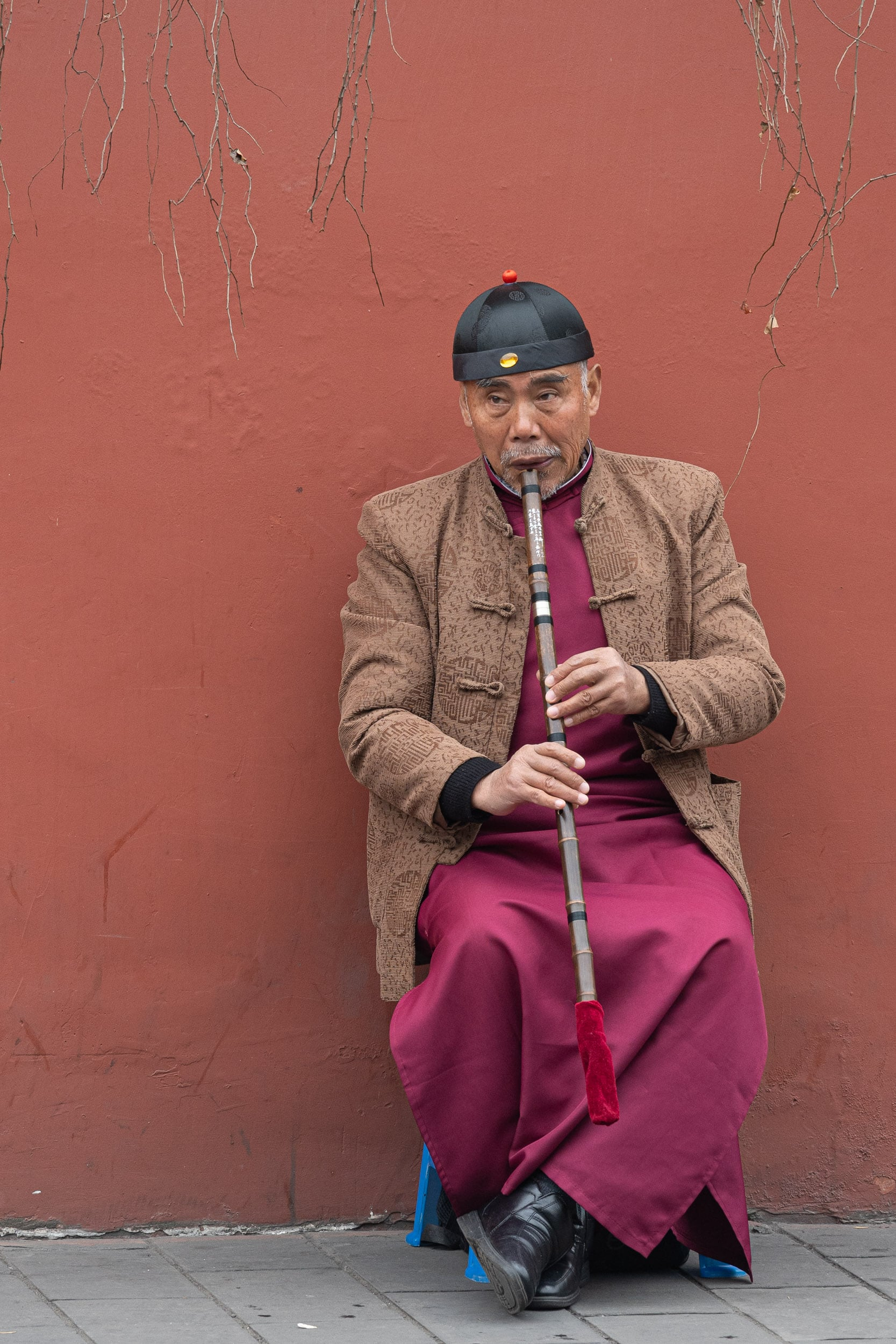 chinese man playing flute
